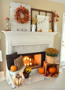 Decorate your fireplace mantel with fall home decor in warm colors like orange and brown. #pumpkins #falldecor #homedesign: Decorate your fireplace mantel with fall home decor in warm colors like orange and brown. #pumpkins #falldecor #homedesign