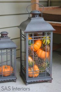 fill lanterns with pumpkins and whatnot instead of candles for a festive indoor look: fill lanterns with pumpkins and whatnot instead of candles for a festive indoor look