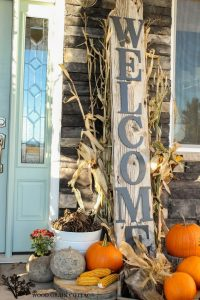 Fall Front Porchwith a large rustic welcome sign, cornstalks, pumpkins, and pine cones: Fall Front Porchwith a large rustic welcome sign, cornstalks, pumpkins, and pine cones