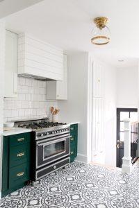 Emerald Bright Green Kitchen Cabinets Black White Patterned Tile White Subway Tile backsplash White Upper cabinets