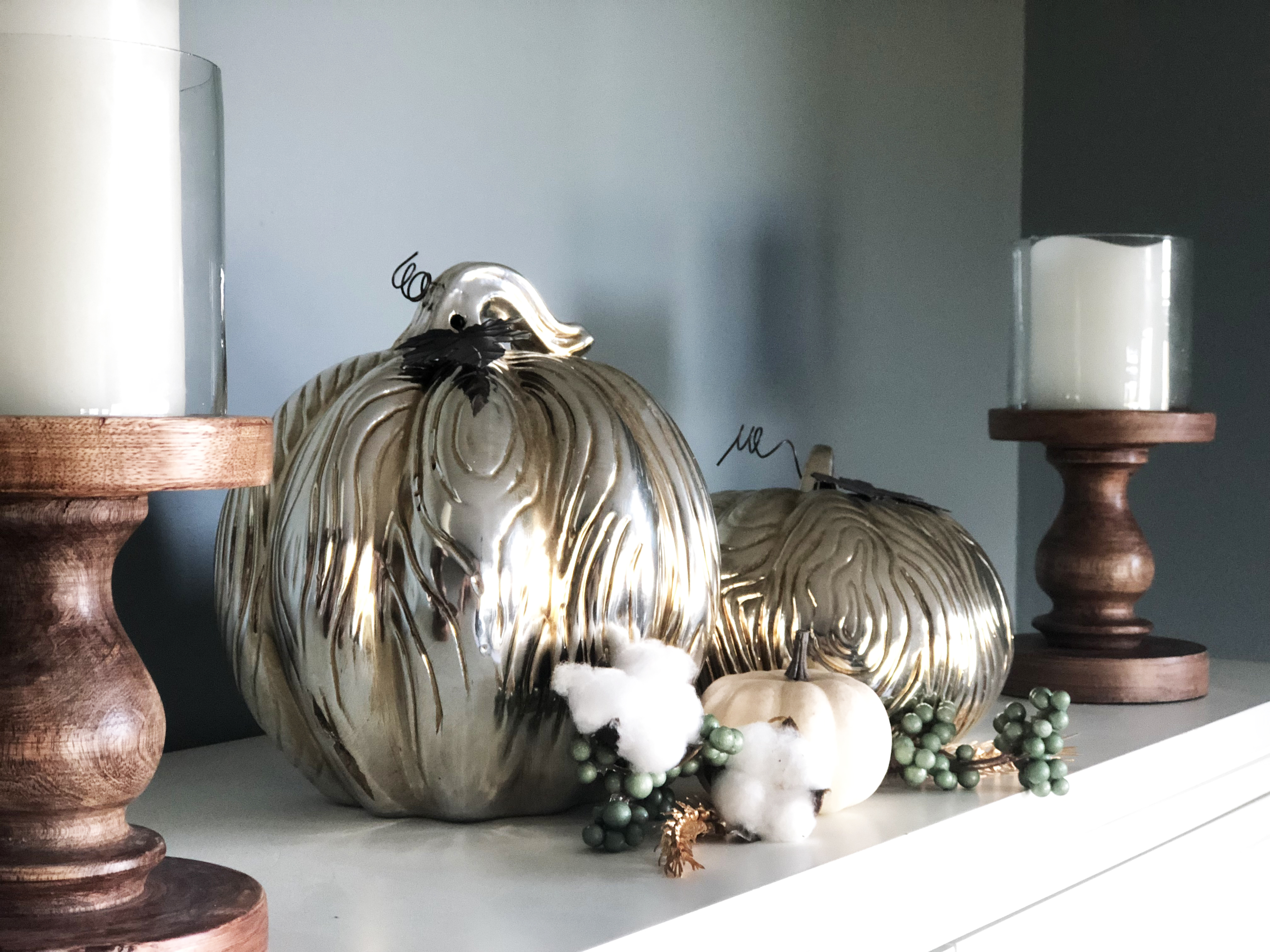 Gold Carved Pumpkins with white mini pumpkin, cotton and wood candlesticks