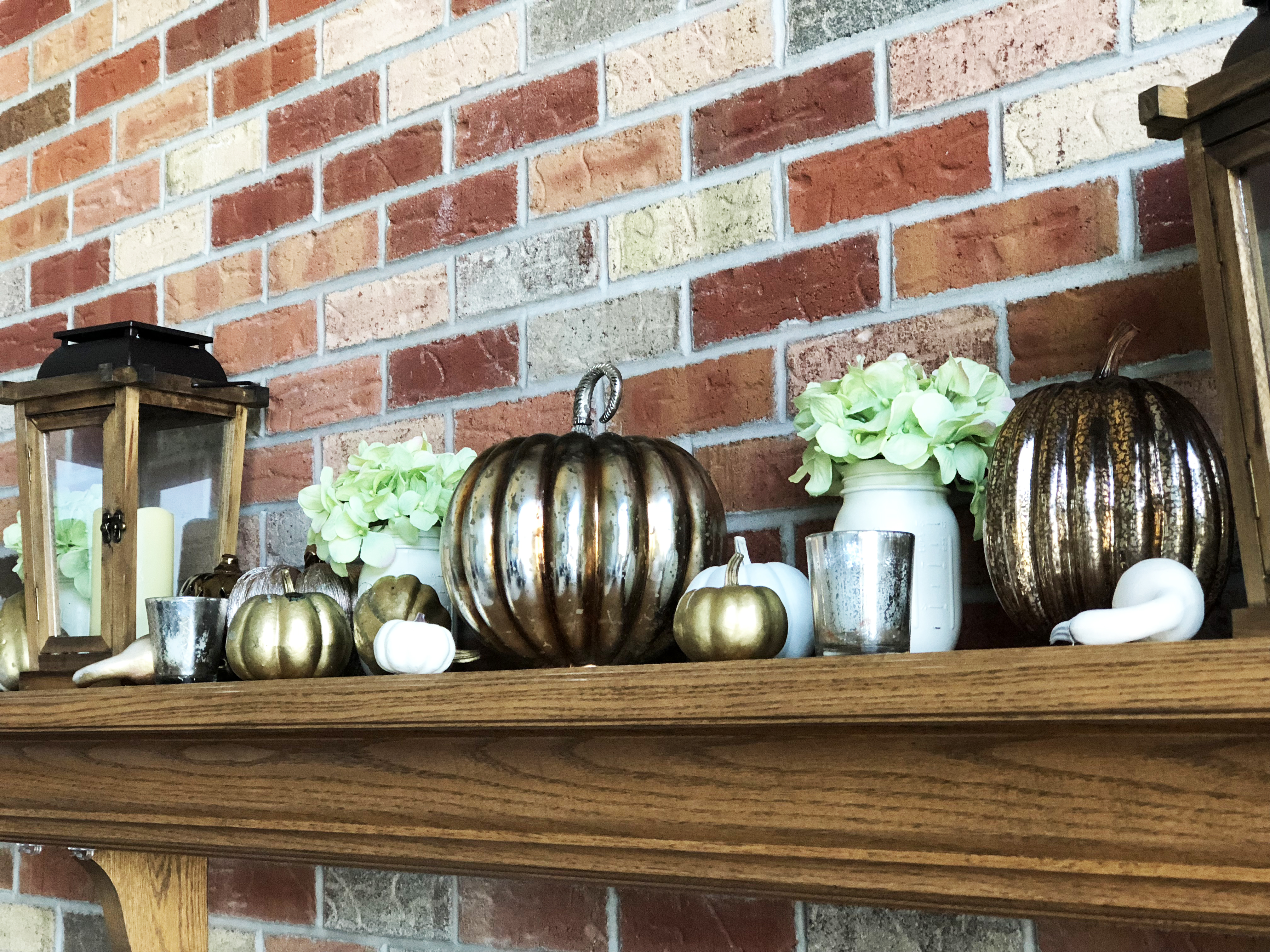 Gold Pumpkins with Wood Lanterns, White Ball Jars and mercury votives and green hydrangeas