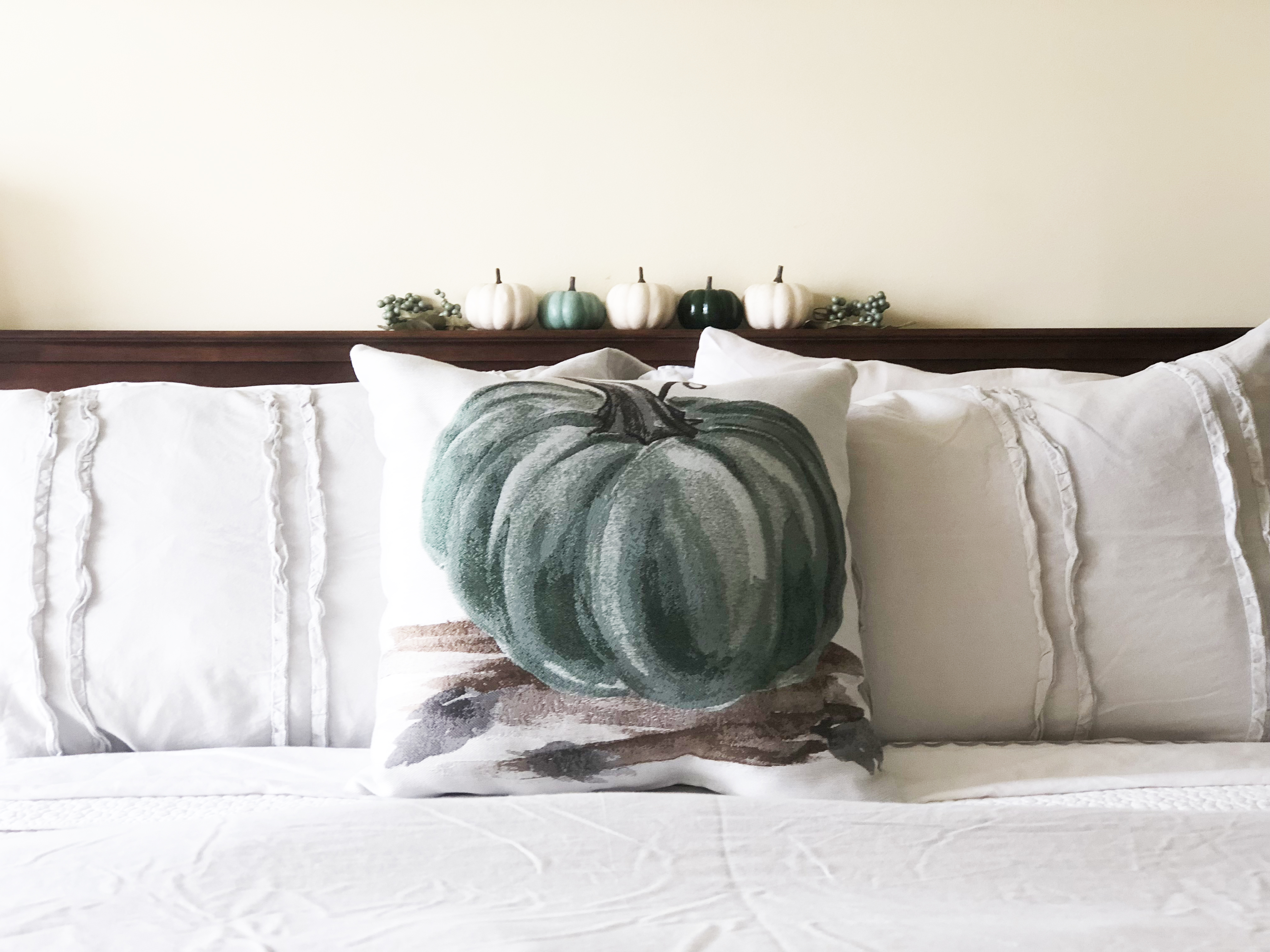 Fall Blue Pumpkin Throw Pillow on Gray Ruffle bedding with white and sage green pumpkins