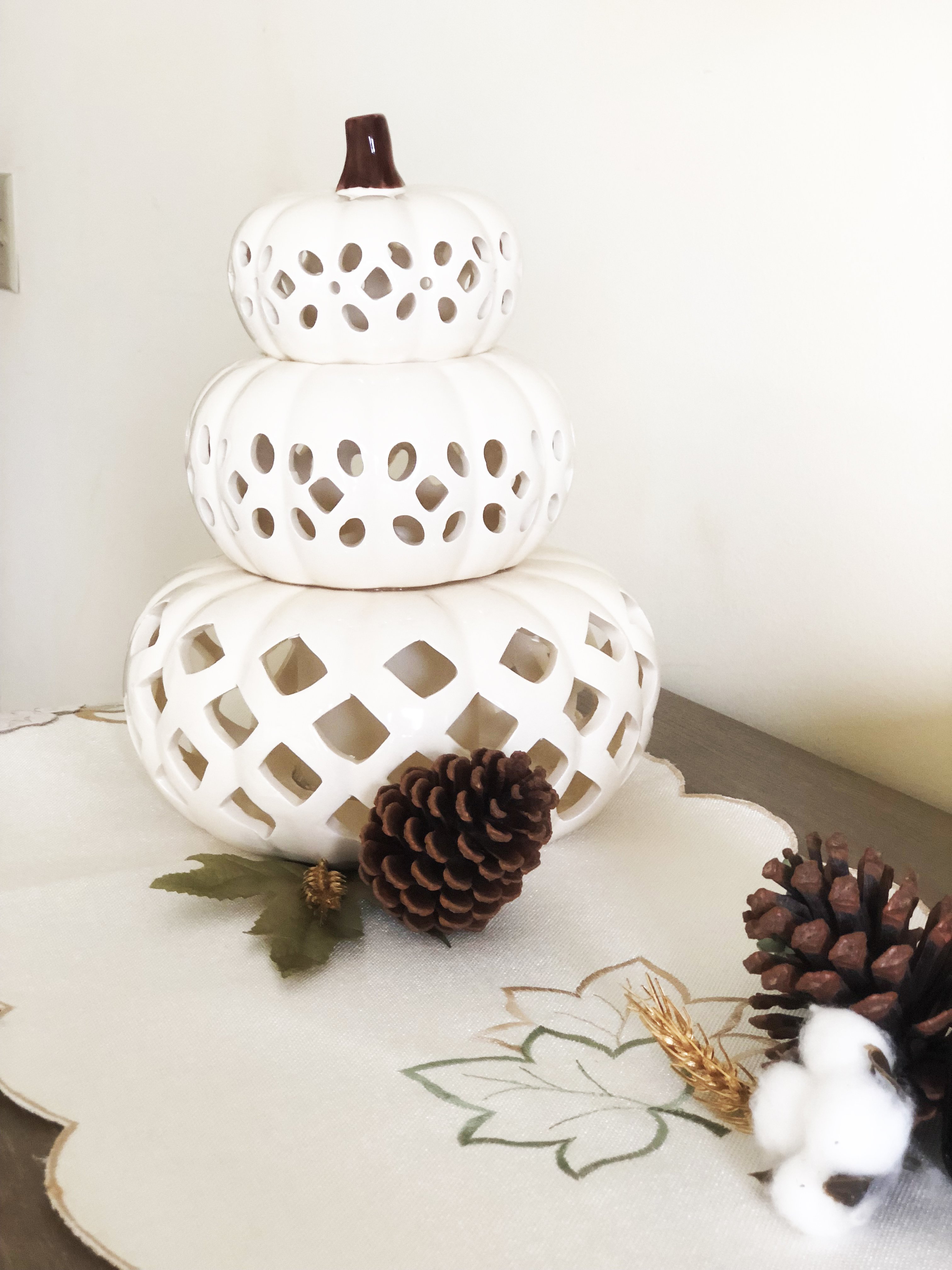 White Carved Stacked Pumpkin with pincones fall table runner on gray wash dresser