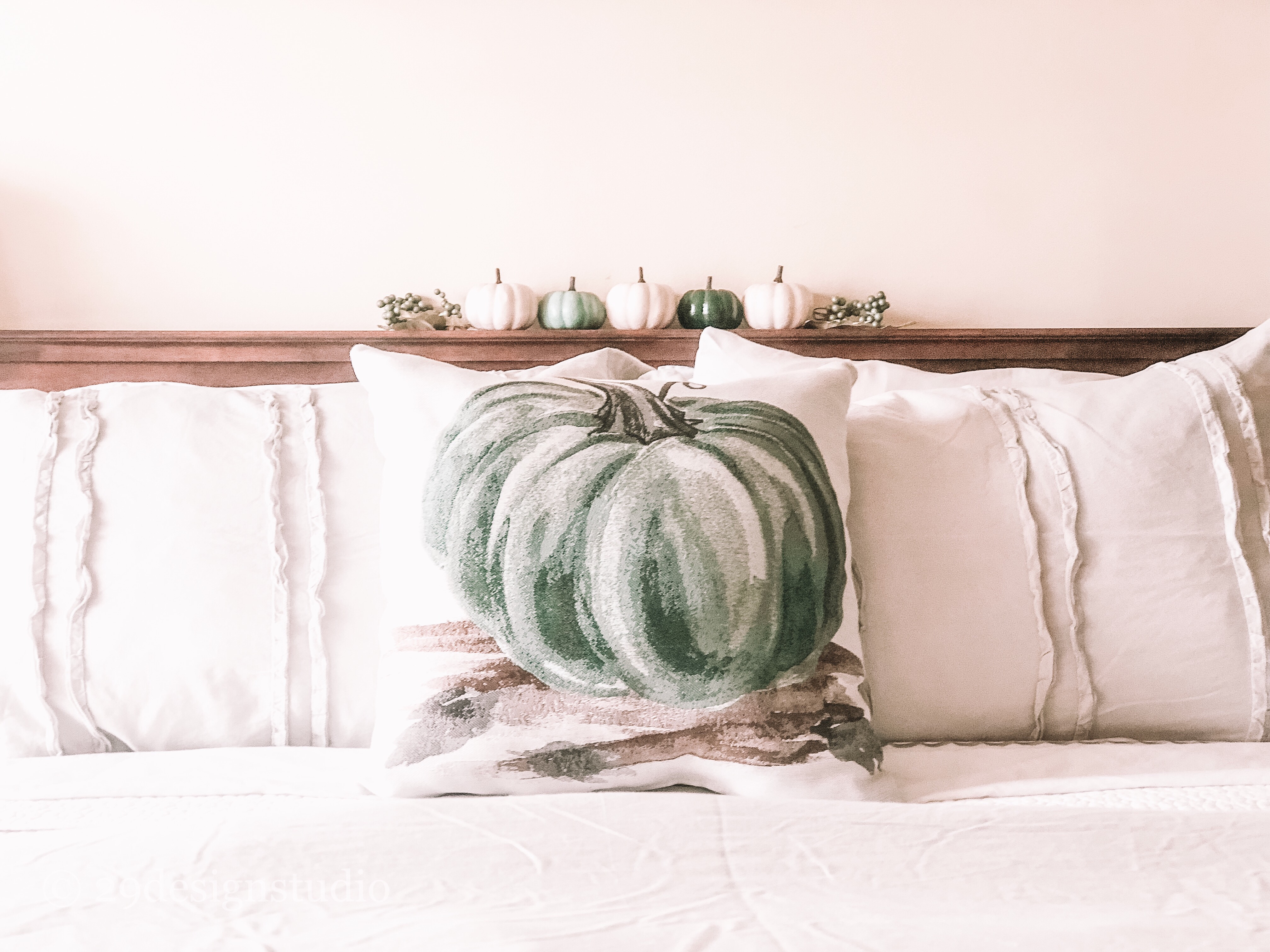 Gray Ruffle Bedding with Green Pumpkin Throw Pillow and white and green mini pumpkins