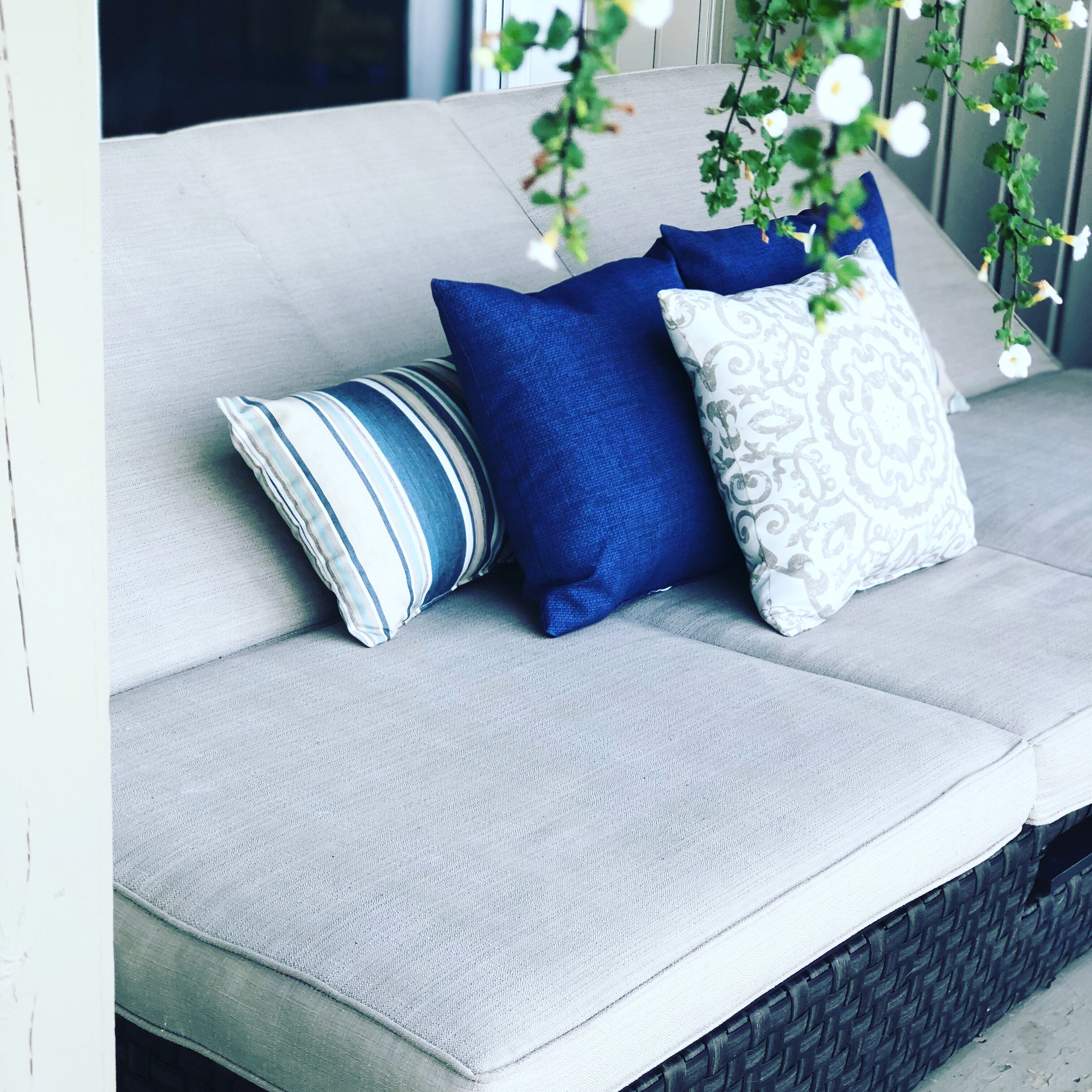 Walmart Wicker Convertible Chaise and Loveseat with Blue and Tan Accent Pillows