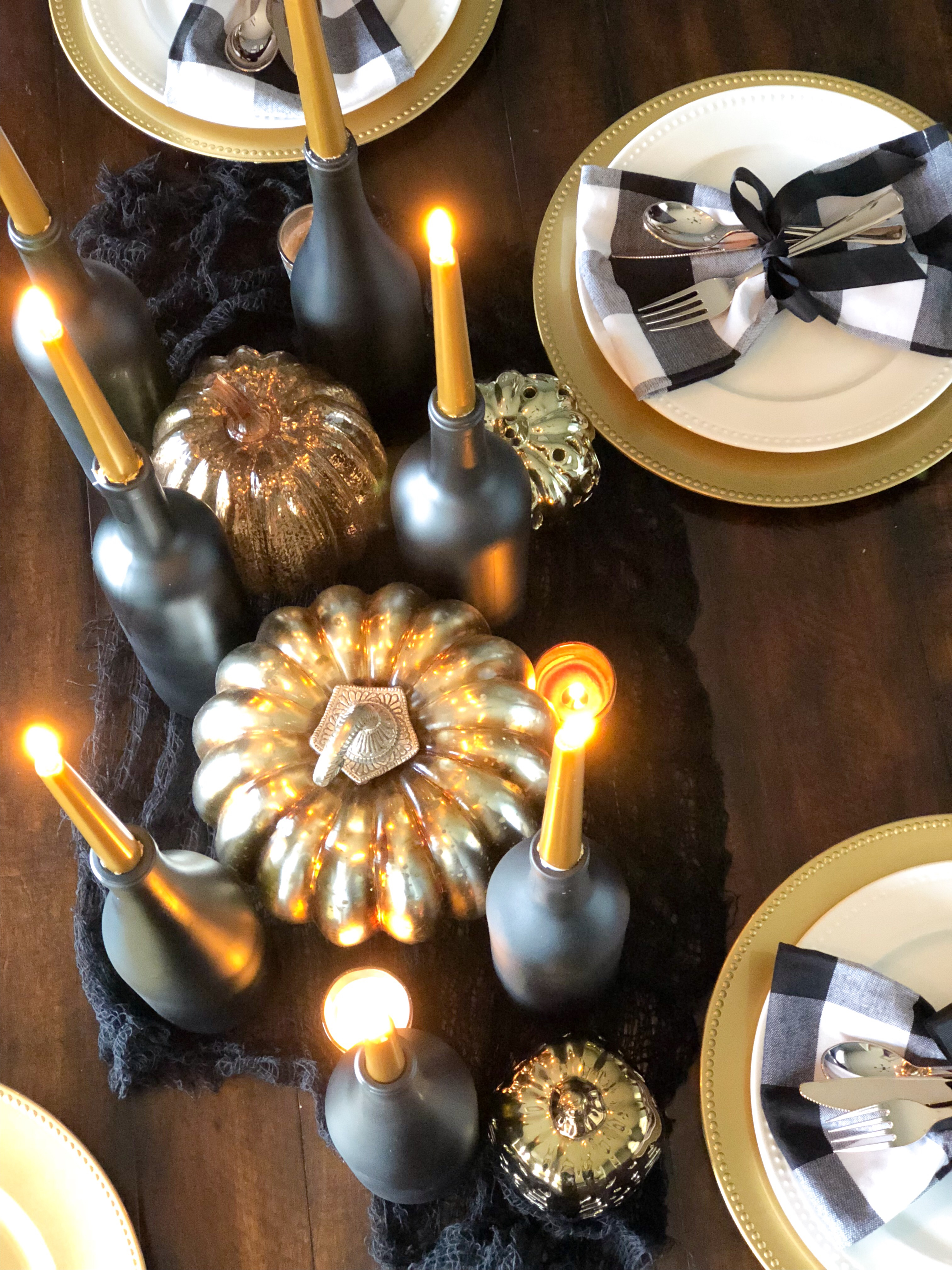 Matte Black Painted Wine Bottles for candle holders with gold candlesticks and gold pumpkins