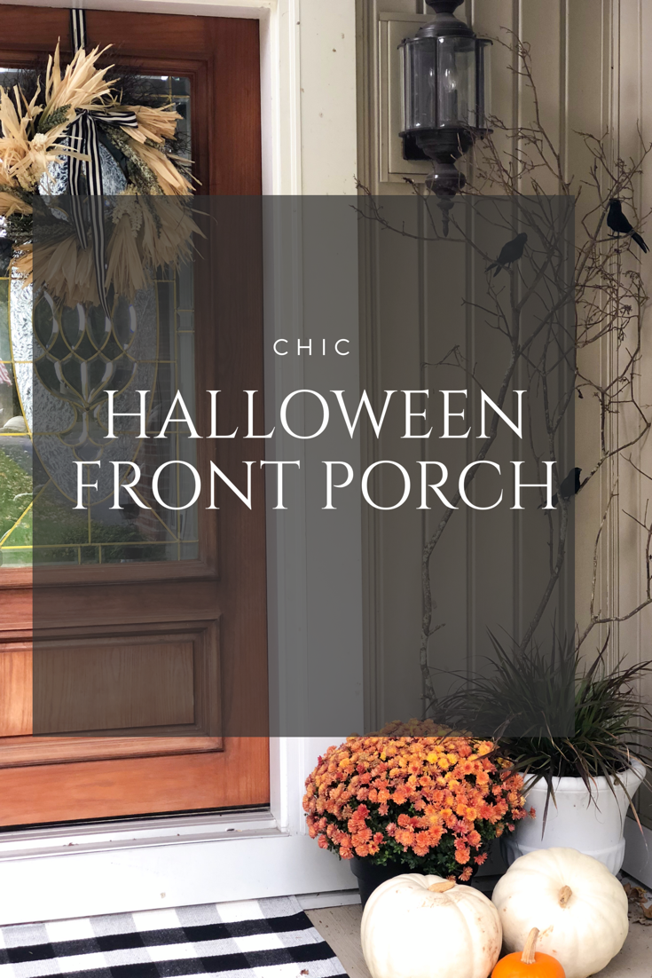 Halloween front porch with tree branches with black crows, orange mums and purple fountain grass, black and white buffalo check rug