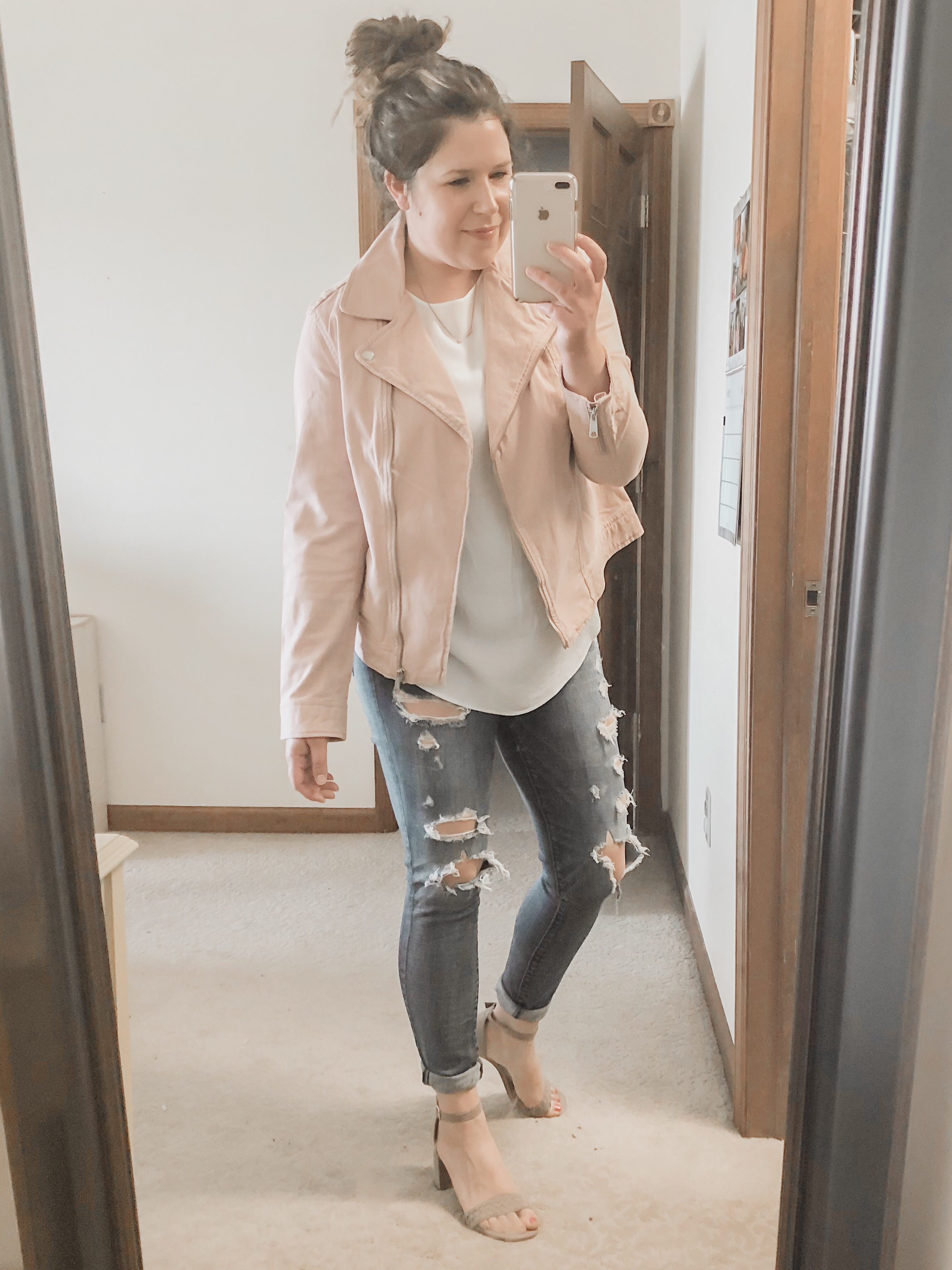 Pink Moto jacket date night outfit with ripped jeans and heels