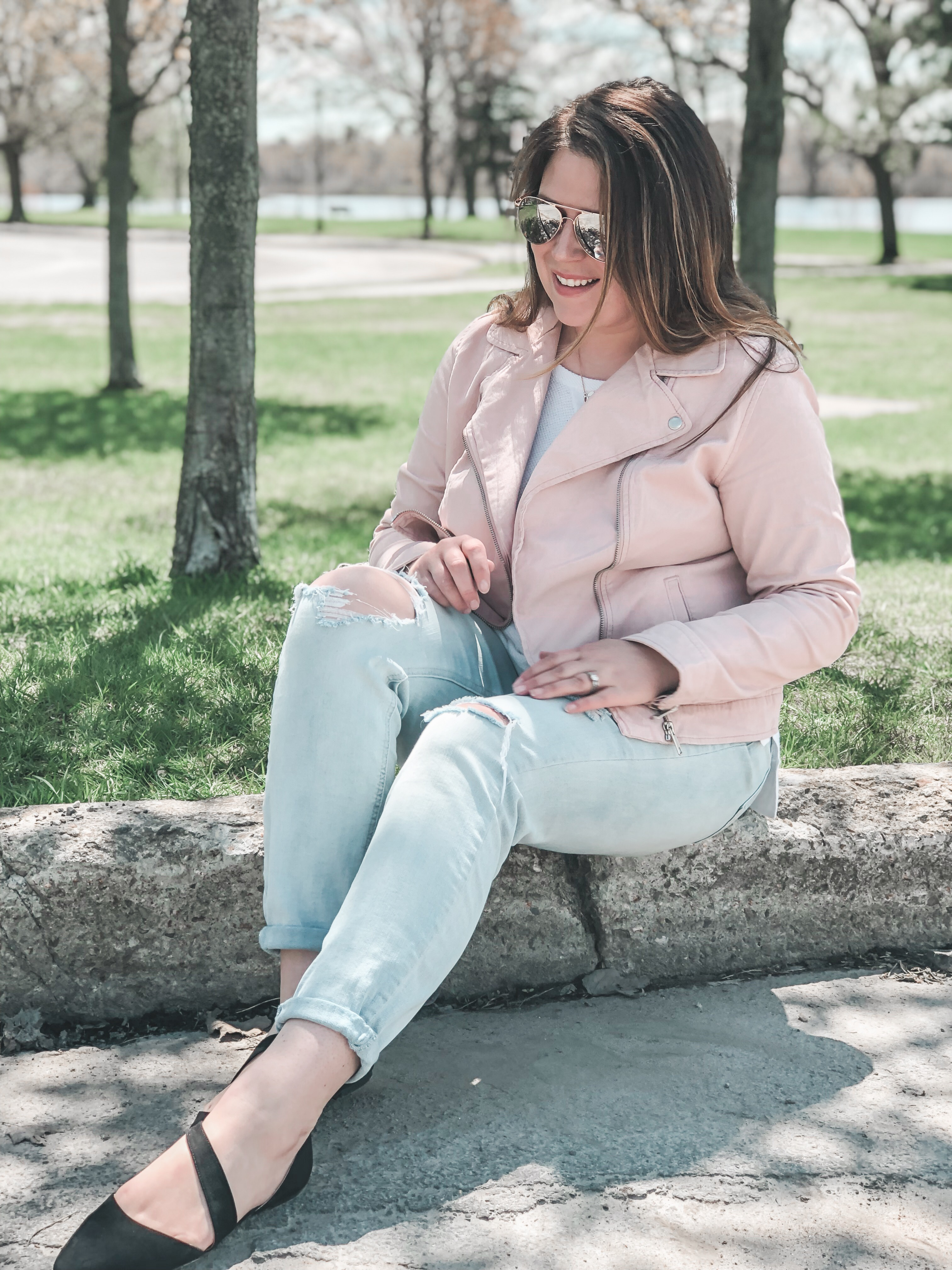 Pink Moto jacket casual outfit with ripped jeans and flats
