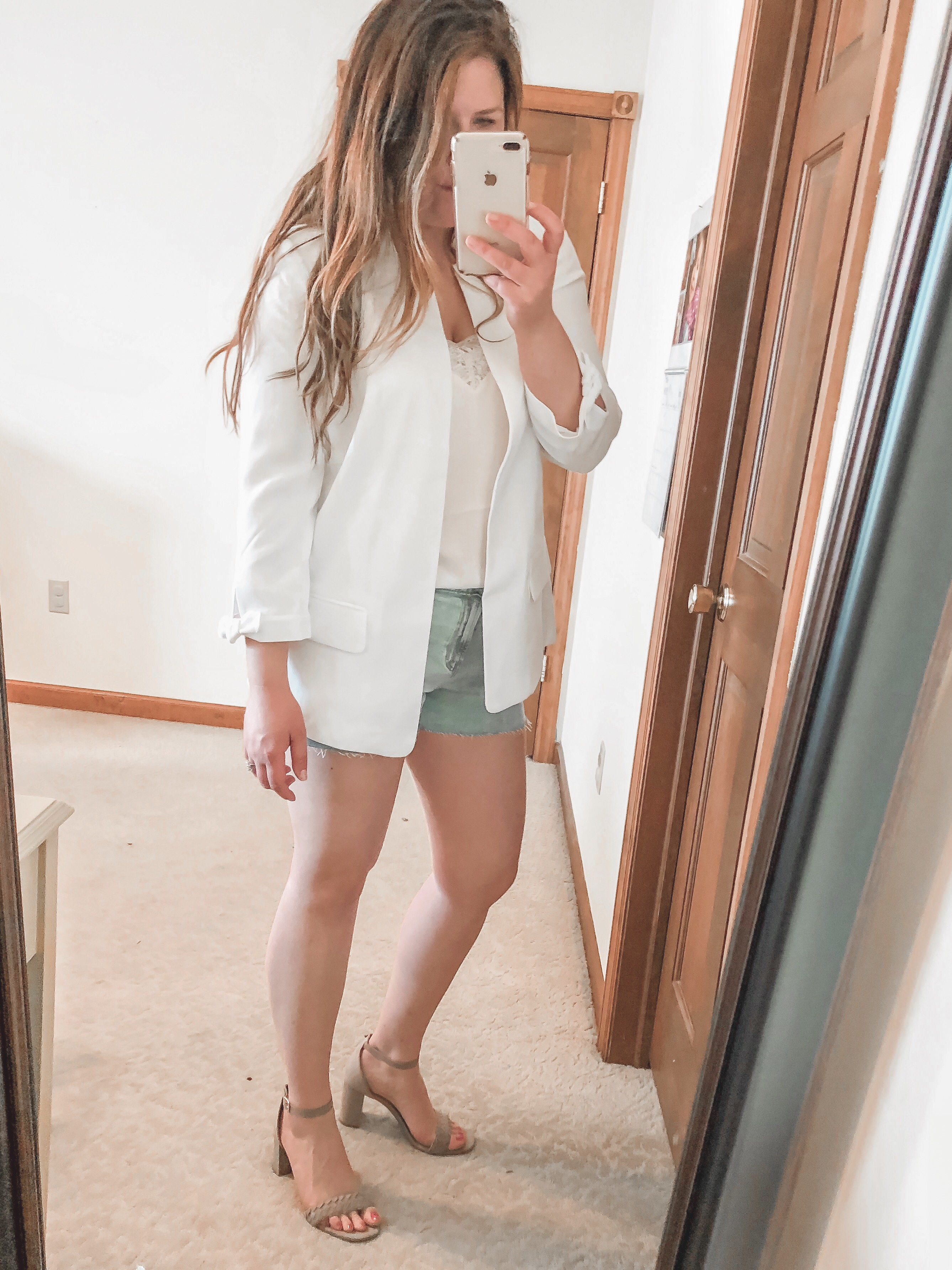 Spring outfit: White boyfriend blazer and denim shorts outfit with lace cami